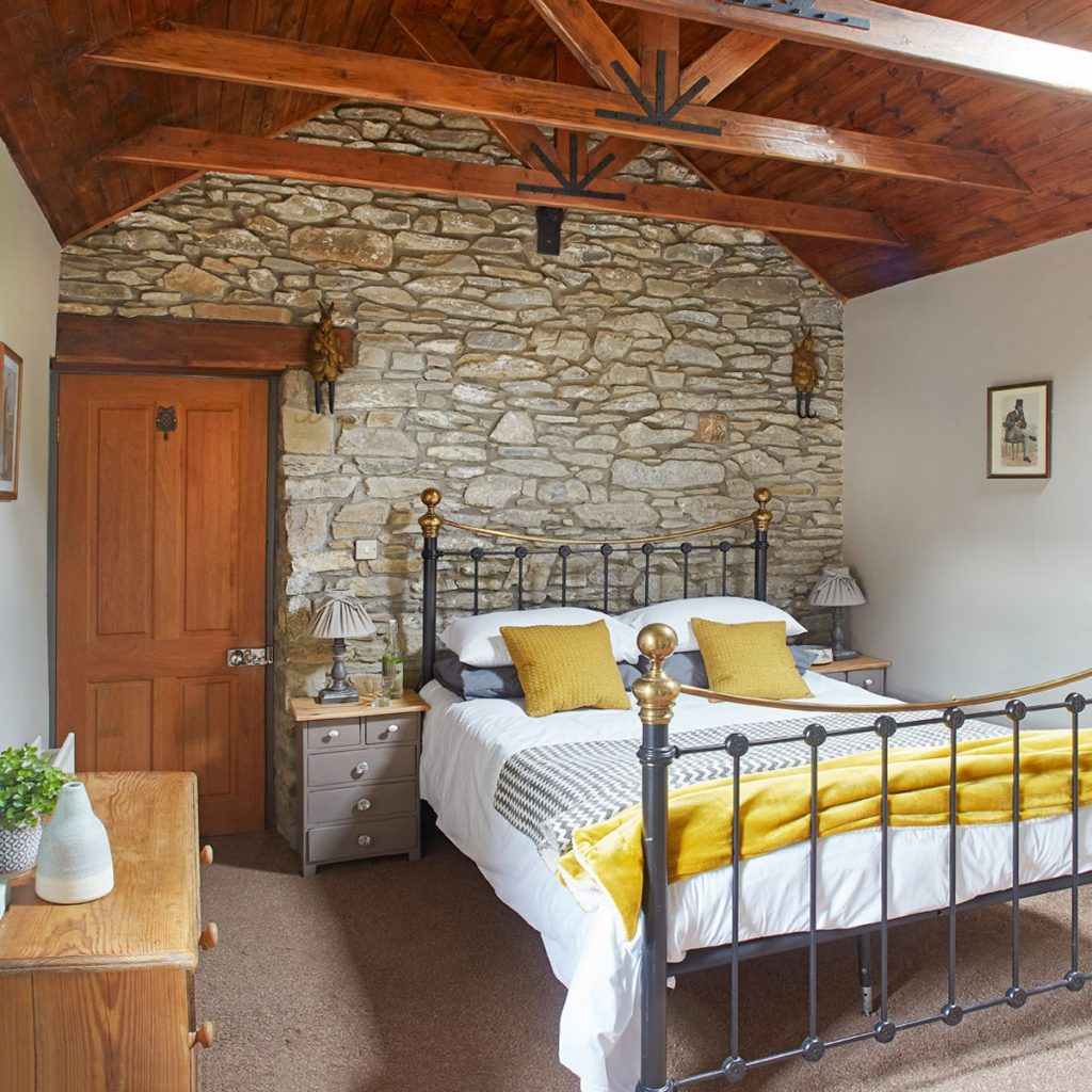 Romantic boutique stone country house double bedroom